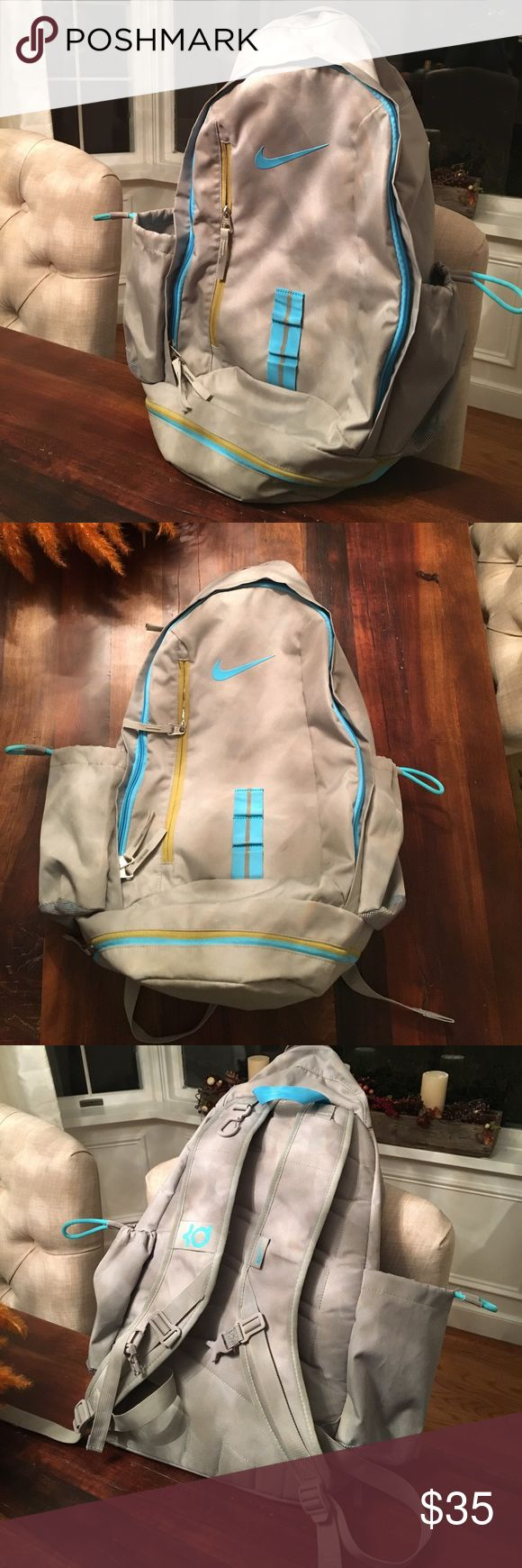 Nike KD Backpack Gently used KD backpack. Has multiple big pockets and is a gray color with blue detailing, there's one slight pen mark that's pictured. Nike Bags Backpacks