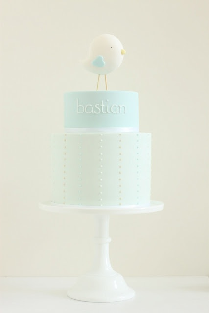 love the simplicity of the cake, the font for the writing & the adorable bird on top