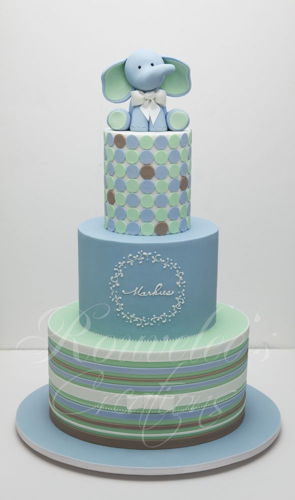 Blue and green elephant children's cake with brown and blue stripes