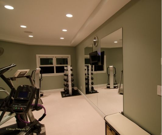 Home gym idea with large door mirrors gyms