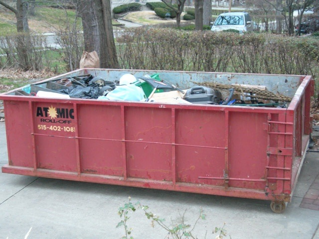 "Decluttering tip:  rent a dumpster!  It's easier to toss out ""stuff"" when you have a place to toss it!"