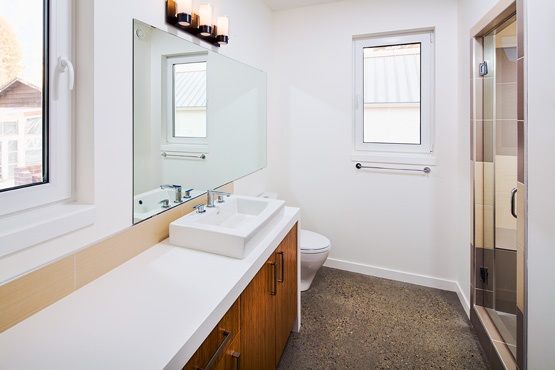 Polished concrete bathroom, radiant heating. Exposed aggregate.
