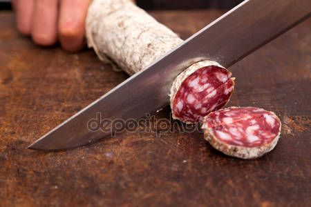 Carnicero cortando salame — Foto de stock © william87 #7312301