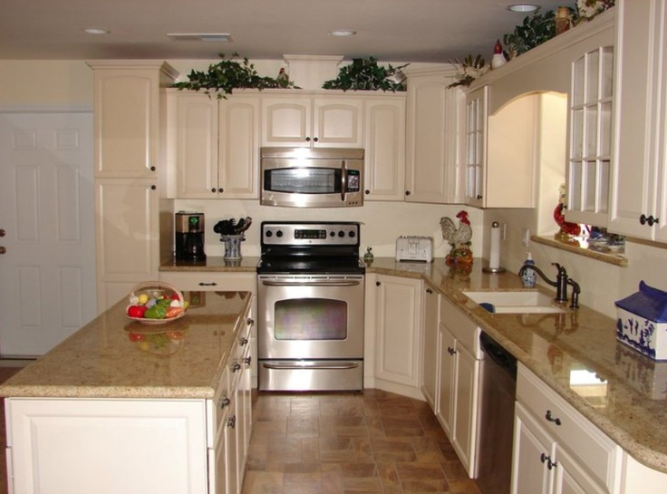 KraftMaid Bisque Glaze Cabinets With Granite Countertops.