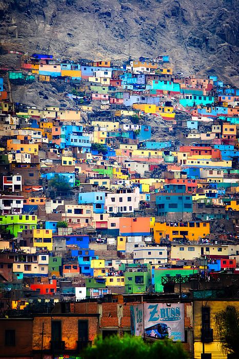 "Lima -- I remember seeing all of the partially finished houses, with crow-bar sticking up everywhere.  It was so ALIVE.  I was told they would use their money for braces for the kids or whatever, then continue to build the house when they could...  these homes look a bit ""nicer"" than what I remember..."