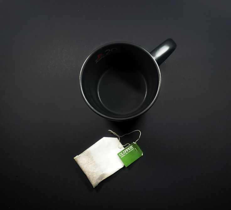Playstation 20th anniversary mug and green tea / Black background