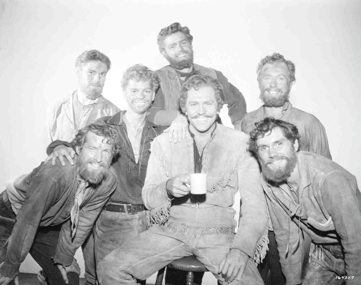 publicity shot of Matt Mattox as Caleb, Tommy Rall as Frank, Russ Tamblyn as Gideon, Jeff Richards as Benjamin, Howard Keel as Adam, Mark Platt as Daniel and Jacques d'Amboise as Ephraim. Seven Brides for Seven Brothers (1954)