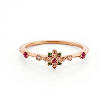 Kataoka Pink Sapphire & Emerald Flower Ring  Diamonds, pink sapphire, and emerald each offer different meanings; the rose gold setting underscores a deep connection to love.