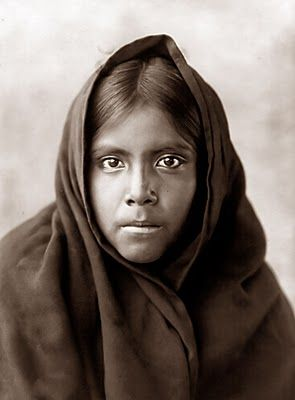 Taken in 1907, it shows a Qahatika Indian Girl. This is another portrait by Edward Curtis. The thing I have noticed in looking at these pictures of Native American women is that their names are almost never recorded. More often than not, names of the men were recorded, but on the women, at best they are identified as someone's wife or daughter.