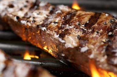 Use This Technique for the Perfect Grilled Steak: New York strip steak on the grill