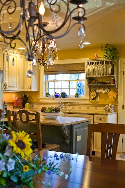 And another French Country Kitchen - yellow walls and blue glass in window -sigh!