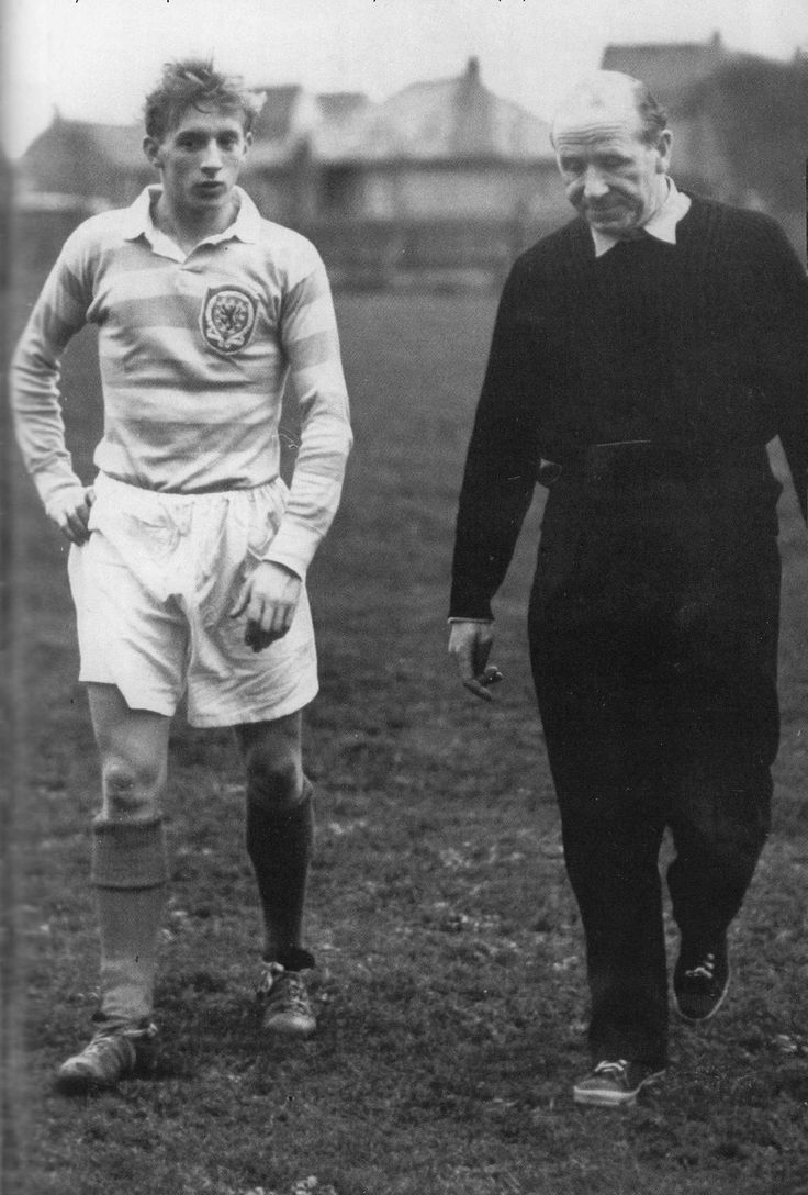 October 1958. Huddersfield Town inside forward Denis Law walking with Matt Busby who had called him up to the Scotland side to play Wales.