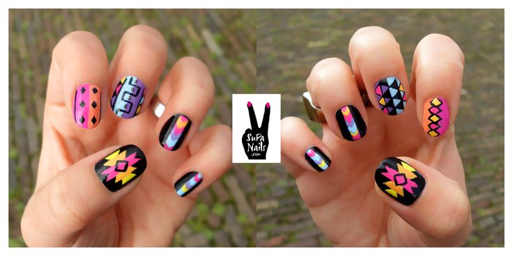 i'm loving all these tribal nails. i like the black here, love the pinky & ring finger nails!