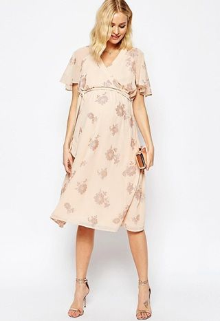 Glitter floral printed peach kaftan style maternity midi dress for a pregnant wedding guest