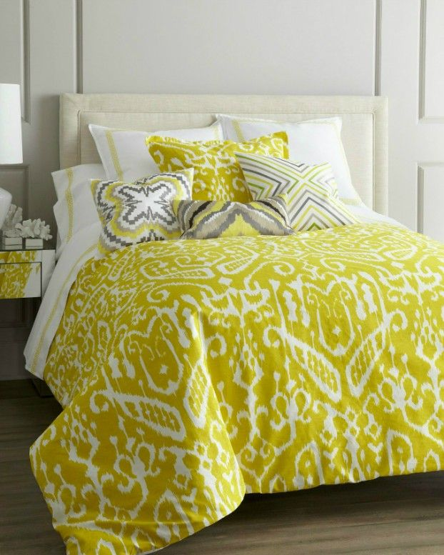 "Yellow and white ""Ikat"" bed linens show the brilliance of Trina Turk. Machine wash linens; spot clean pillows."