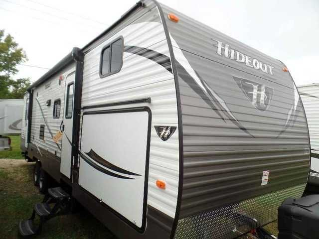 """2016 New KEYSTONE RV HIDEOUT 300LHS Travel Trailer in Wisconsin WI.Recreational Vehicle, rv, CHECKOUT THE MANY FEATURES OF THIS COOL RV WITH A FRONT BUNKHOUSE AND FRONT OUTSIDE CAMP KITCHEN. Sleeps 6+, interior surround sound speakers, Bluetooth DVD/CD/MP3 Stereo, HD LED TV, microwave, 6 Cu. Ft. Refrigerator, Ball Bearing Drawer Guides, full strutted storage under master bed, built in 30,000 BTU furnace, 81"""" interior height, foot flush toilet, pre-drilled residential cabinetry throughout…"""