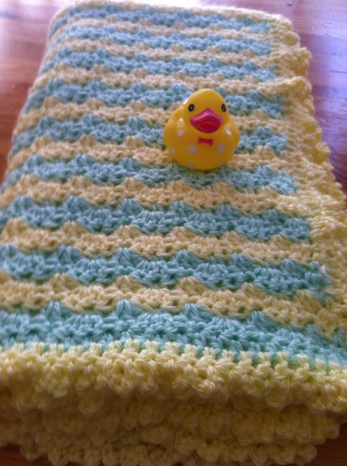 Baby blanket in green and yellow stripes