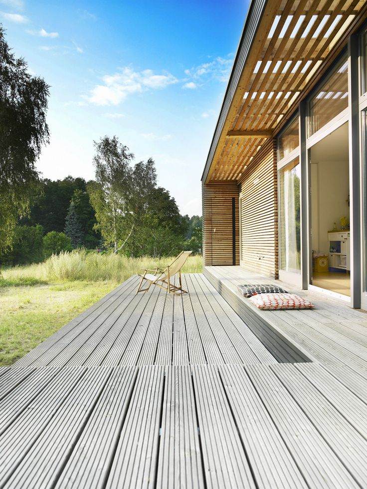 a collaborative effort between germany based patrick frey + björn götte has led to the development of 'sommerhaus piu',   a prefabricated wooden vacation home. simple, elegant and versatile, the facade is defined by thin horizontal strips of wood.   a slightly pitched roof edged with charcoal planks allows natural light to enter clerestory windows into the living spaces while   bedrooms are protected from direct sunlight with limited windows.