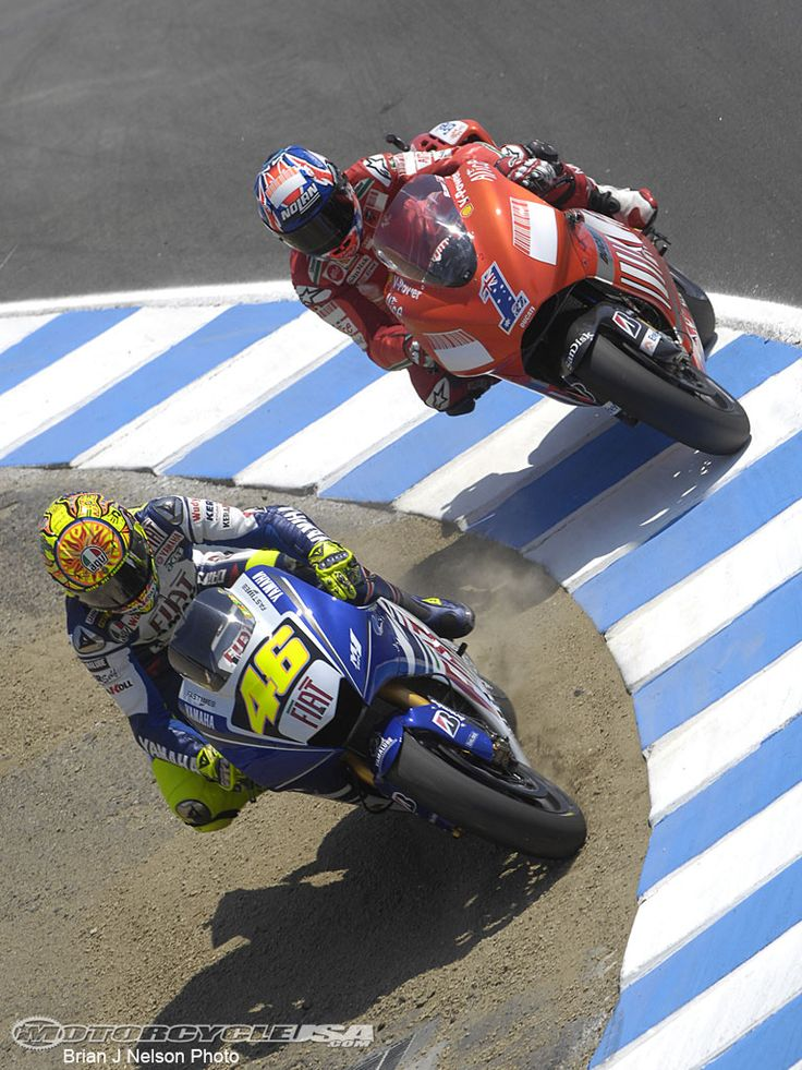The infamous pass at the Laguna Seca corkscrew. Rossi off piste to take Stoner