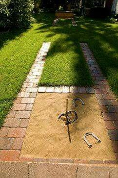 DIY backyard horseshoe pit--don't know about the safety of the metal rod,but the idea seems great.