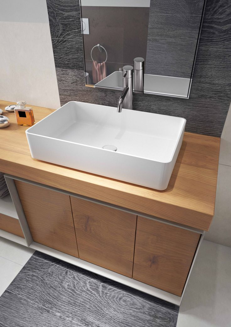 ... Italian-made vessel sink is durable in material and timeless in style