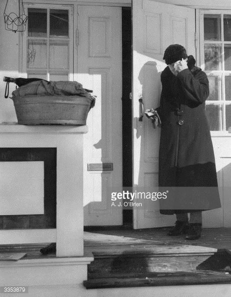 26th March 1940: An old lady breaking down as she leaves her home in Hango. The area was ceded to the Soviet Union by Finland after the Russo - Finnish war. (Photo by A. J. O'Brien/Fox Photos/Getty Images)