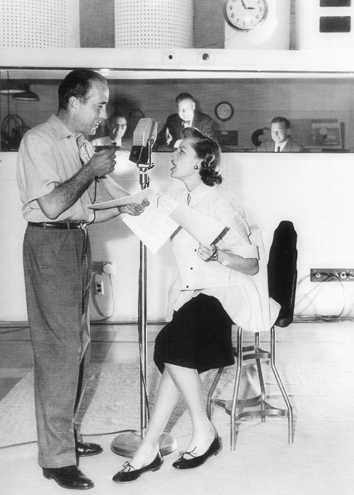 Humphrey Bogart and Lauren Bacall at a radio station, 1952 (Photographed by Sid Avery)