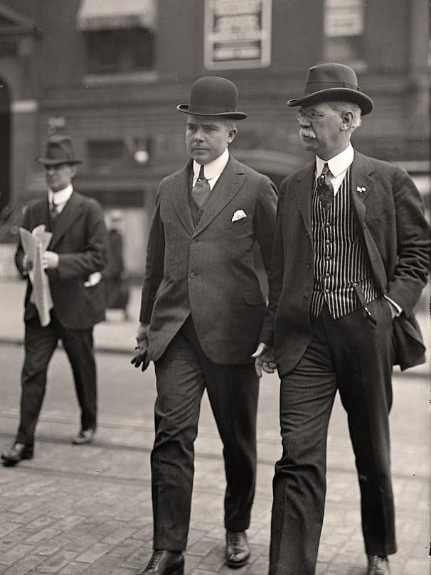A popular trend for men around 1910 was the transition into more comfortable suits which featured high collars and bold stripes.