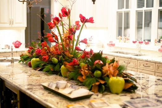 Holiday themed centerpiece for a kitchen island. Taken from Markham's Homes for the Holidays house tour.  Photo by Laura Mills.