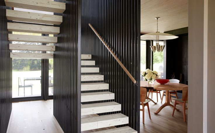 Modern Entry and Hall in Wainscott, NY by Damon Liss Design