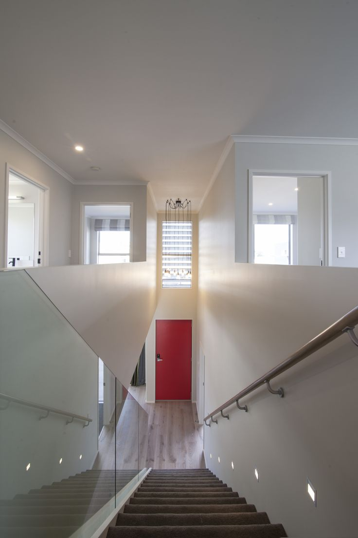 Looking down the staircase in this open and modern G.J.Gardner Home.