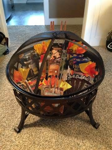 Silent auction basket ... Fire pit, roasting sticks and rests, pie ...