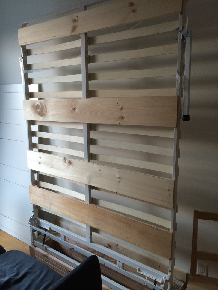 Pin for Later: Save Space and Money With This DIY Murphy Bed  To make the bottom of the bed less of an eyesore, add wooden slats and attach panels.