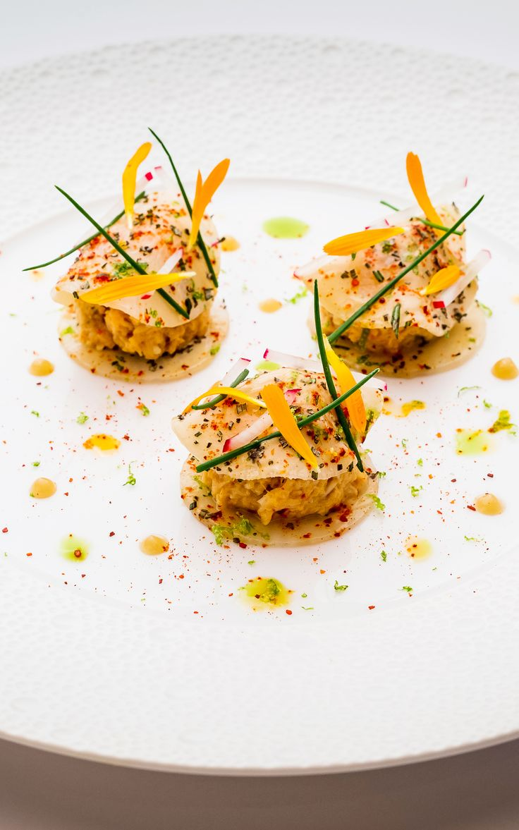 Crabmeat with thin ravioli of turnips, rosemary, sweet and sour dressing by Xavier Boyer