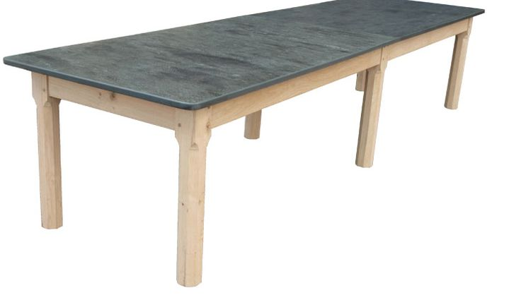 The Large Table Above Was Specially Bespoke Made For A Court Yard Garden On The Isle Of White It Measures12ft Long And 40 inches Wide. The Top Is Made In Two Large Halves Of Solid Slate Butted Together The Six Square Chamfered Legs Give the Table A Solid But Elegant Look. The Table Was Left Unfinished to Allow For The Natural Silvering Effect That Happens To Oak When It Is Exposed To The Weather. www.slatetoptables.com