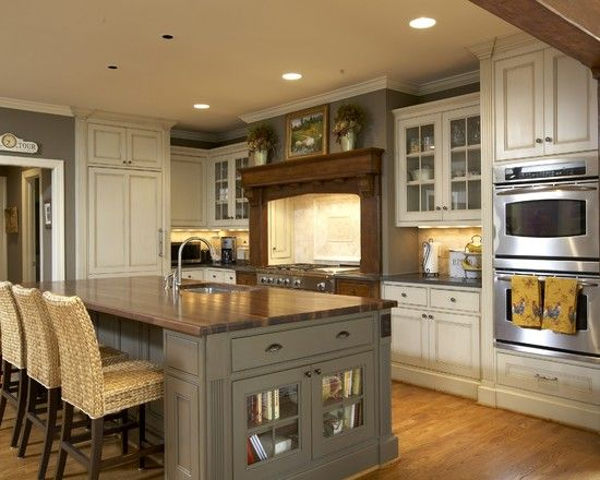 Love the gray island with the cream cabinets, stainless, and wood. Very warm and inviting.