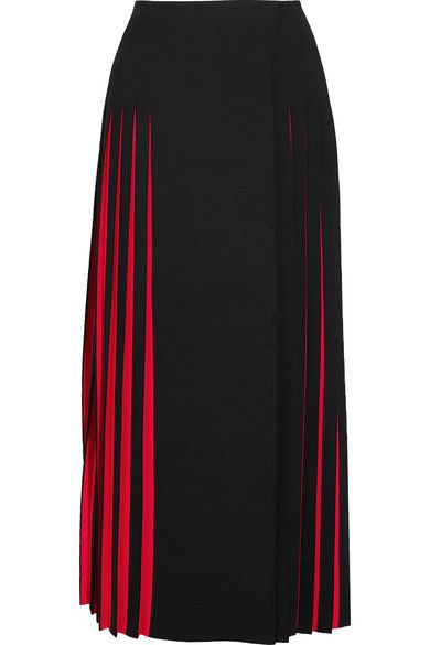 Azzedine Alaïa marches to the beat of his own drum - he shows outside of the expected Fashion Week schedule to an intimate crowd in Paris. This black knitted skirt reveals graphic flashes of red through hand-stitched knife pleats and is intended to sit at the most flattering - and comfortable - part of your waist. Style it effortlessly with sandals.