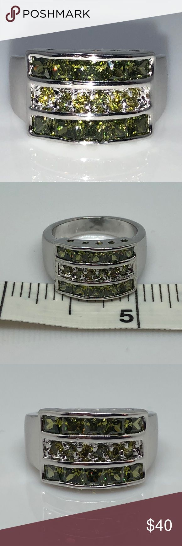 PP 925 Princess Cut Peridot Invisible Setting Sz7 Platinum Plated Stamped 925 Sterling Silver 10 Princess Cut Peridots in an Invisible Setting with 6 round peridots in the center Size 7 Jewelry Rings