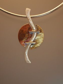 Forged sterling silver with textured copper and brass