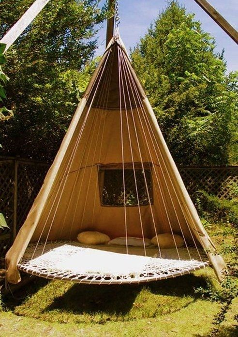 Re-purposed trampoline. Use extra horizontal reinforcement beneath it and hang in the giant oak tree. What kid wouldnt have wonderful day dreams there? Love the little window, though here mosquito netting might be better to let the breeze thru.