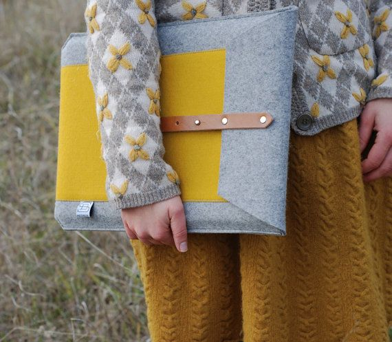 The Laptop Case by sketchbook on Etsy, $100.00 and love the model's sweater and skirt colors and combinations