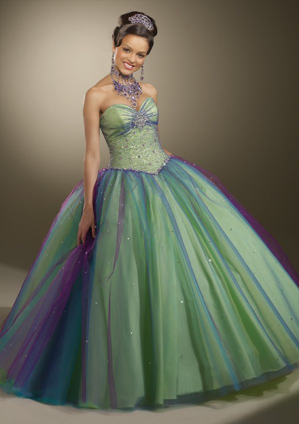 QUINCEANERA VIZCAYA By Mori Lee Style 87096.  The skirt has a yellow base, with green, blue and purple layers of tulle