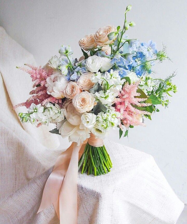 Pretty Pastel Wedding Bouquet: White Peonies, White Lisianthus, White Stock, Peach Ranunculus, Pink Astilbe, Light Blue Delphinium