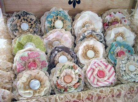 Like chocolates in a candy box.  I would love to wear one of these brooches.  Must make some.