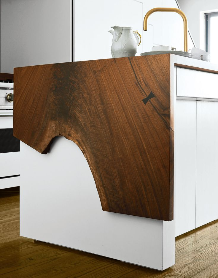 could be cool detail at leasing desk or the kitchen island.  waterfall edge with natural material over white surface.