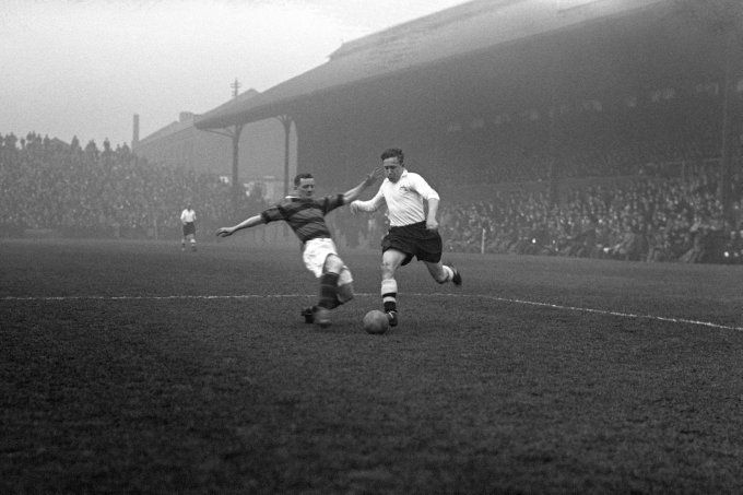 1936. Fulham's Johnny Arnold attempts to skip past Bradford defender Bob Danskin