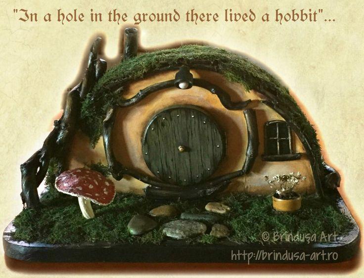 Hobbit home no. 2, painted in acrylics: out of wood, fabric, dried up moss, rocks & a tin can. You can open the door & store things inside. Căsuţa de hobbit nr. 2, pictată-n acrilice, confecţionată din lemn, material textil, muşchi, pietre & o conservă. Se poate deschide uşa, se pot păstra lucruri în interior. #repurposing #recycling #repurposed #painting #reciclare #handmade #paintedbox #tin #acrylics #acrilice #cutiepictata #tolkien #hobbit #littlehouse #unique #unicat #BrindusaArt