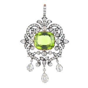 LOT:451 | A mid Victorian silver and gold peridot and diamond pendant, circa 1850.