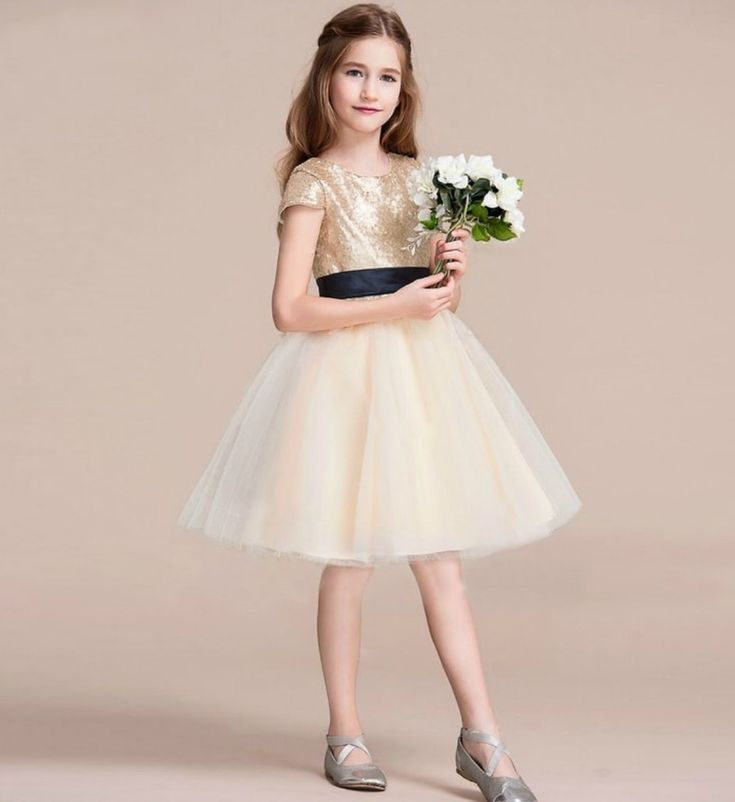 Sequin Dress-Made To Order - High Quality Sparkle Gold Sequin Round Neckline Cap Sleeve Knee Length Infant Toddler Little & Big Girl Tutu Dress With Sash Belt. Available from 3 -16 years. Material: Cotton & tulle mesh. Color: Gold & Champagne. Please do compare your  little girl measurements with our size chart below or you may leave a note your little girl's height, bust and waist measurements so we can process it and send you the right size.