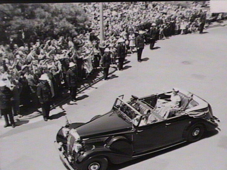 Queen Elizabeth drives to   Sunday Service at St. Andrews Cathedral,   Sydney Australia 1954.          Find more detailed information about this photograph:  http://acms.sl.nsw.gov.au/item/itemDetailPaged.aspx?itemID=227080    From the collection of the State Library of New South Wales http://www.sl.nsw.gov.au